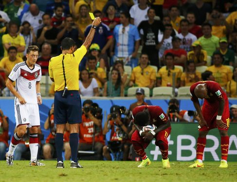 Ghana's Muntari reacts after being shown the yellow card by the referee during their 2014 World Cup Group G soccer match against Germany at the Castelao arena in Fortaleza